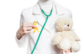 Doctor with gold ribbon and teddy bear isolated on white. Gold ribbon. International Childhood Cancer Day