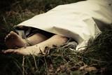 Murder victim lying outdoors under sheet - 136256808