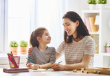 woman teaches child the alphabet