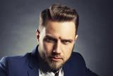 Man with fresh stile hair cut over dark background - 136277699