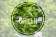 Eat more green words on green vegetable hydroponic food background.