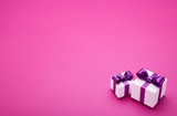 Gifts with bows on pink