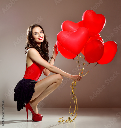 Poster Woman with red heart balloon. Beautiful girl with bunch of heart