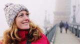 Outdoors portrait of happy woman walking on Budapest