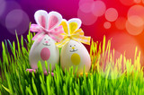Colored easter eggs bunny on green grass