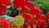 NHA TRANG, KHANH HOA/VIETNAM - JANUARY 26 2017: Wind shakes hung up large nice red Chinese lanterns on street market in city before Vietnamese new year TET on January 26 in Nha Trang