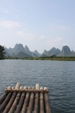 Mountain and river scenery during raft ride in Yangshuo, Guilin region, Guangxi province, China
