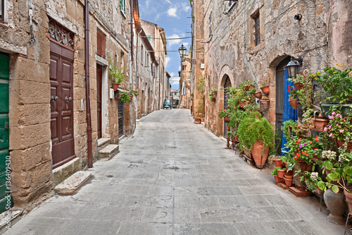 Fototapeta Pitigliano, Tuscany, Italy: alley in the old town