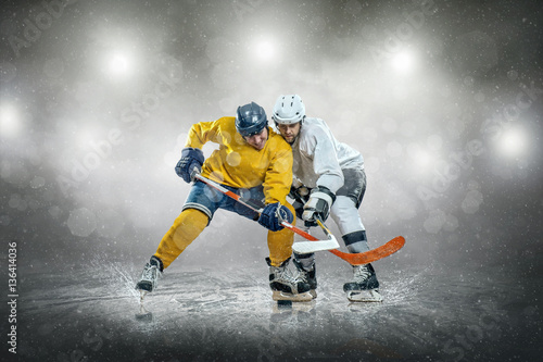 Ice hockey player on the ice, outdoors Poster