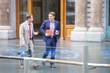 Businessmen walking outside the office
