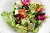 plate of fresh salad. Bon appetit