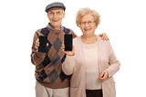 Cheerful seniors showing phones to the camera