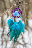 Earrings of Dreamcatcher made of feathers leather beads and ropes, hanging