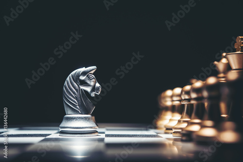Plakat Shot of a chess board silver horse moving.