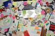 Top view on office desk with laptop computer and post it notes all around. Overwhelmed with work concept.