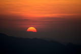 Sunset at the Mountain Hill,Beautiful sunlight, Orange lights background