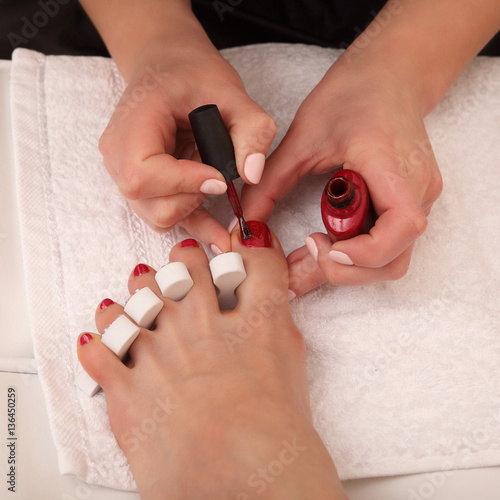 Fotobehang Pedicure Professional pedicure master making it in salon
