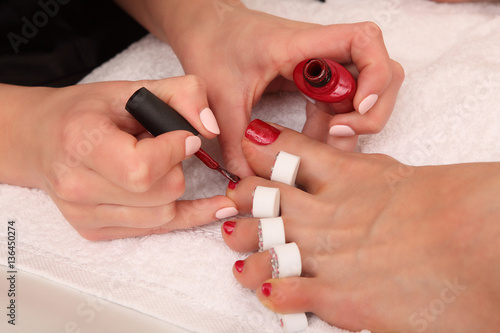 Deurstickers Pedicure Professional pedicure master making it in salon