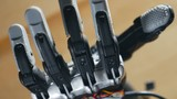 Bionic arm. Innovative robotic hand made on 3D printer. Futuristic technology. 4K.