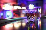 Whiskey grin on shot glass at a bar.