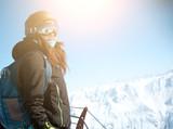 Girl on top of mountain