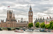 London - view of Big Ben clock tower, Houses of Parliament and Thames river with boats, United Kingdom.