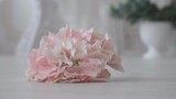 Beautiful bouquet of artificial flowers for decoration falls on the floor. Flowers lie on the floor. Wedding background is