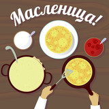 Cooking pancakes top view with word Maslenitsa in russian