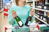 Woman in shop chooses champagne