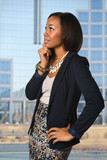 African American Businesswoman With Office Building in backgroun