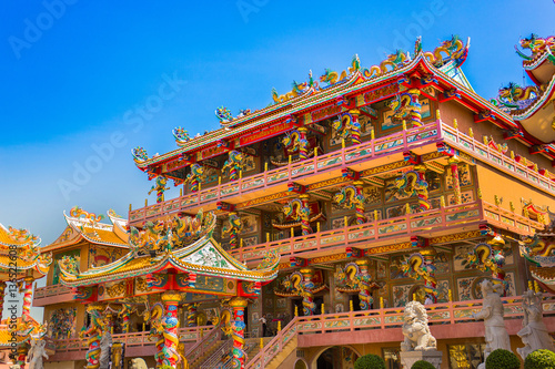 Poster Exterior of Chinese Buddhism temple in Thailand, Chinese guardian lion statue