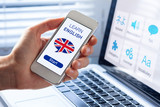 Fototapety Learn English language online concept, mobile phone, flag of UK