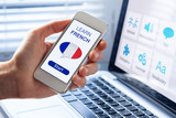 Learn French language online concept, mobile phone, flag of France - 136549671