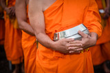 BUDDHIST MONKS : Thai Monks walking in the morning for Receive Food , Thailand.