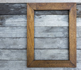 Wooden picture frame over old wooden texture floor