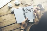 woman written plan text on notebook on desk