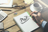 man written plan text on notebook on desk
