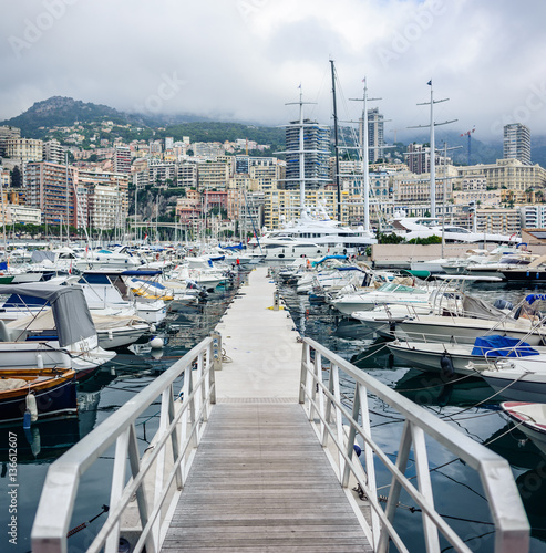 Fotobehang Formule 1 The Principality of Monaco - July, 2016: Monte Carlo harbour city panorama. View of luxury yachts and apartments in harbor of Monaco, Cote d'Azur.