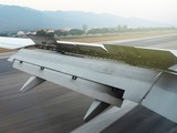 Airplane wing during landing at the airport