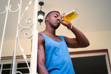 Lonely Unemployed Black Man Drinking Alcohol At Home