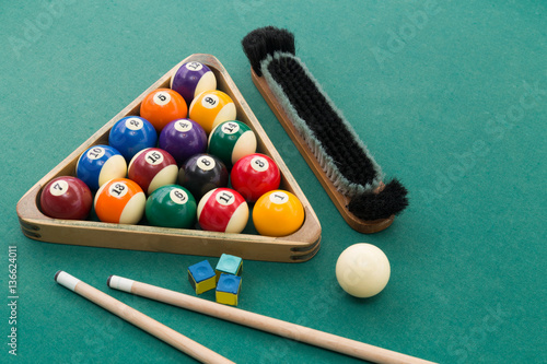 Staande foto Snooker billards pool balls, cue, brush, chalk on green table