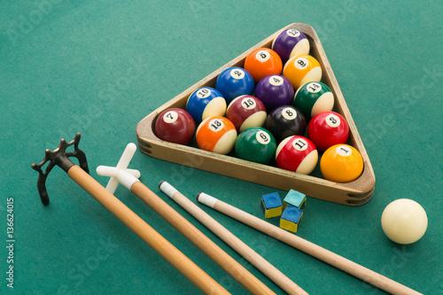 Staande foto Snooker billards pool balls, cue, chalk on green table