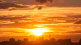 Dramatic sunset with bright Sun over skyline. Moscow, Russia.