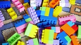 A young child plays in the constructor. Game of the childrens designer. Colored cubes. 3 video in 1