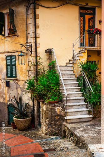 Old marble stairs and house in Tellaro village, Liguria, Italy.