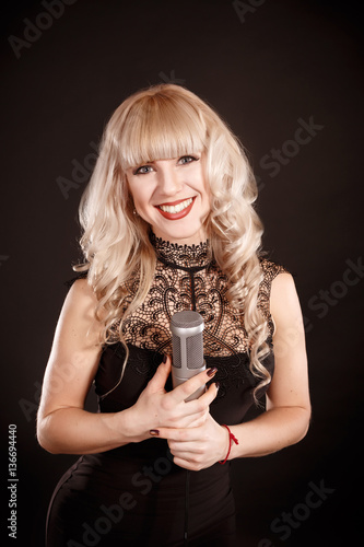 Singing Woman with Retro Microphone. Beauty Glamour Singer Girl Poster