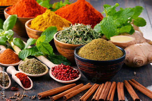 Fototapety, obrazy : Variety of spices and herbs on kitchen table