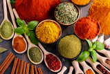 Variety of spices and herbs on kitchen table - 136699665
