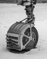 Landing gear of the military aircraft in black & white