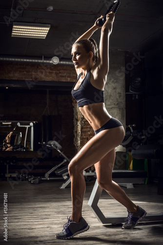 young fitness woman in gym Poster